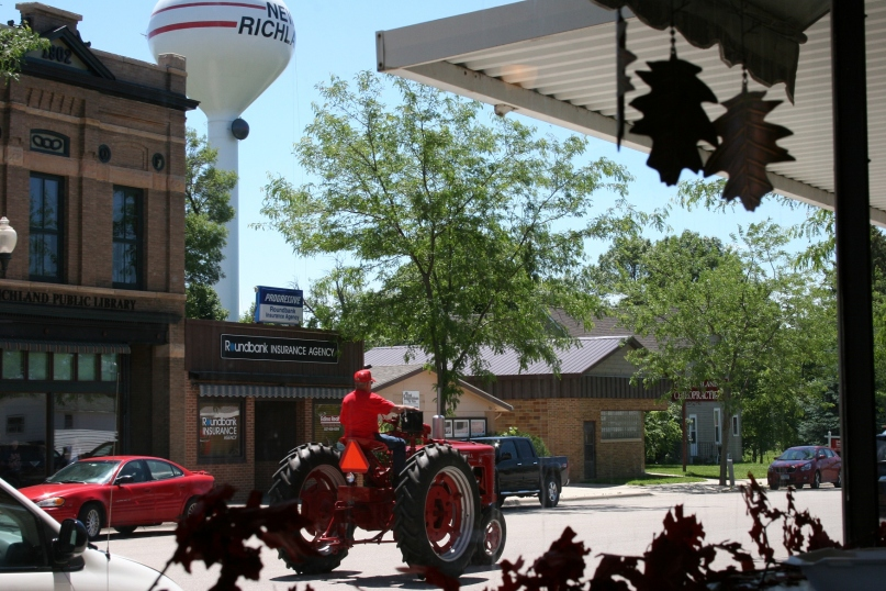 Glancing out the cafe's front window, I noticed the tractorcade rolling into new Richland.
