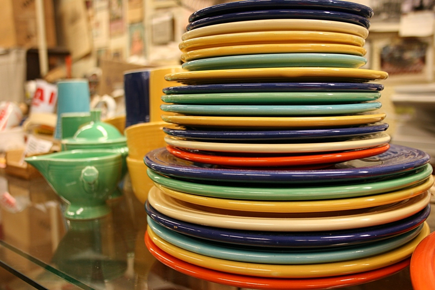 A stack of colorful Fiesta ware awaits a buyer.