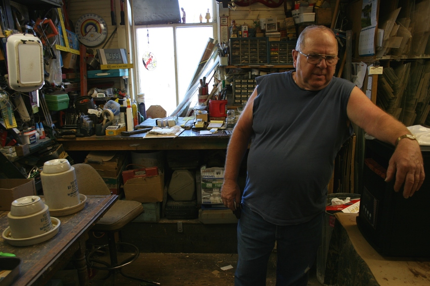 Wayne Wenzel in the back workshop/office area of Dad's Good Stuff.
