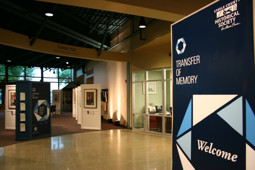 "The Steele County History Center, 1700 Austin Road, Owatonna, is hosting ""Transfer of Memory"" through August 17."