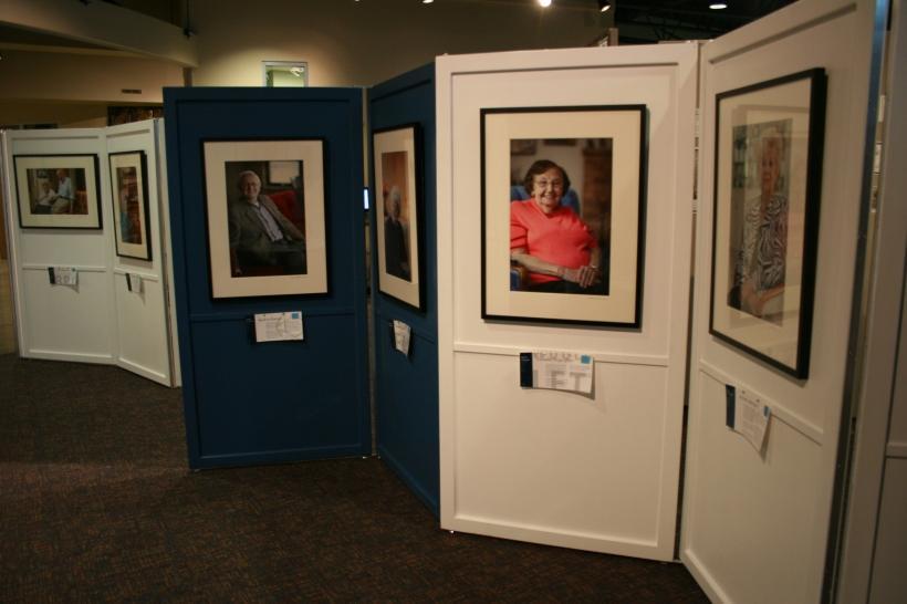 Panels showcase portraits and stories.
