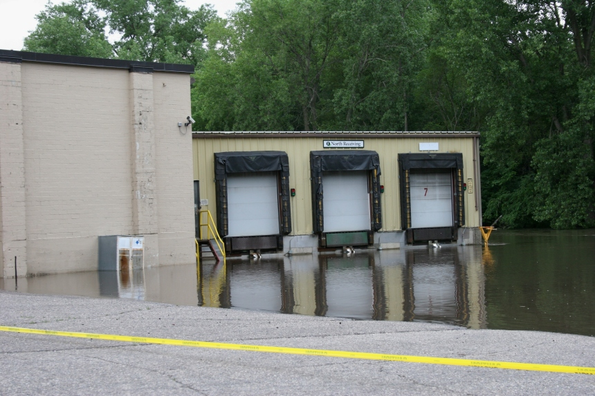 Straight River floodwaters block access to a Faribault Foods loading dock.
