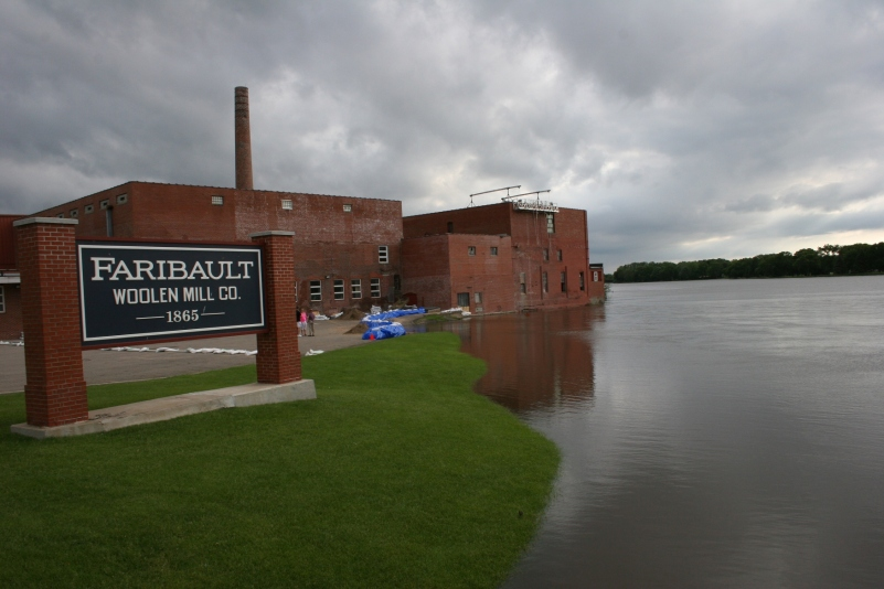 Sandbags protect the Faribault Woolen Mill from the rising Cannon River.