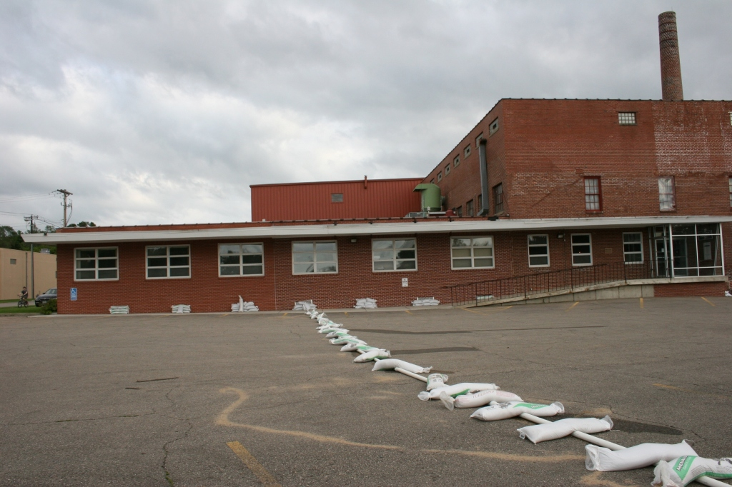 Sandbags hold down a pipe at the Faribault Woolen Mill factory and retail store.
