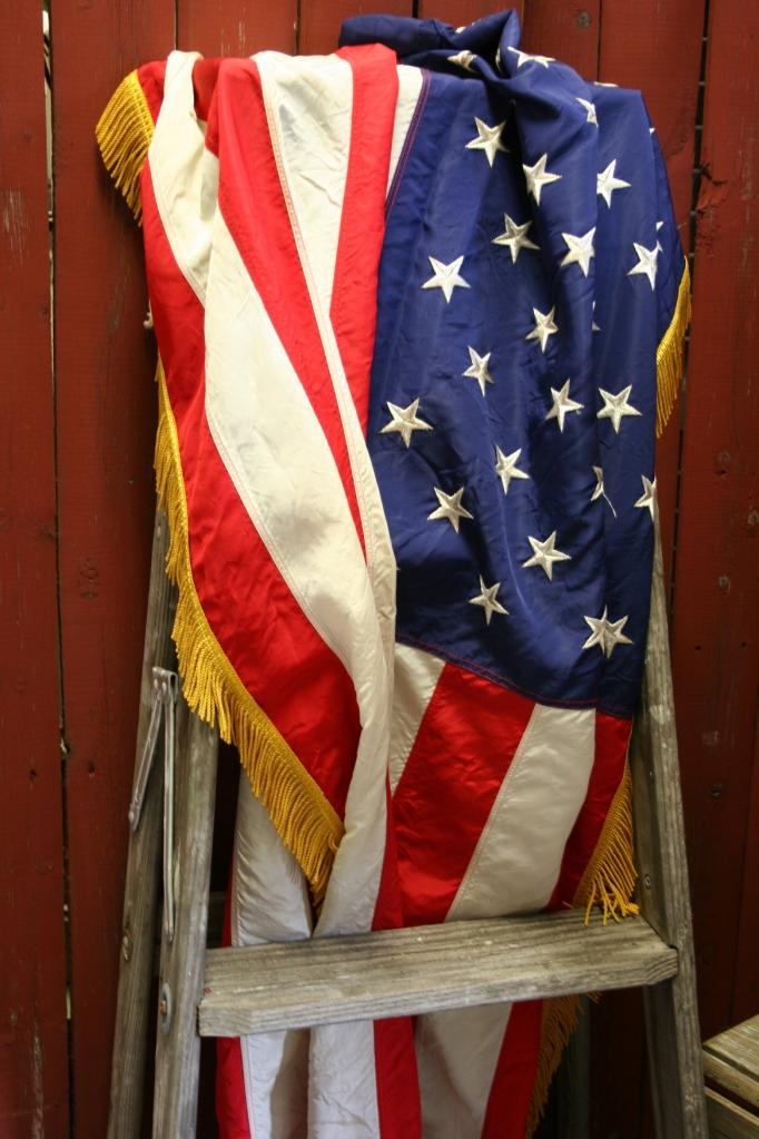 Fourth of July, flag on ladder