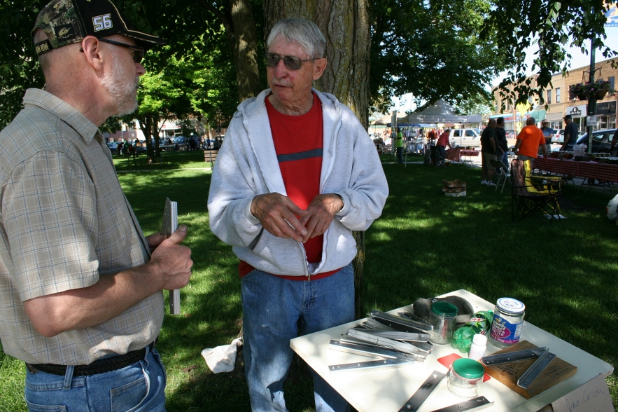 Gene Mosher talks to my husband, Randy, about his jar cover opener.