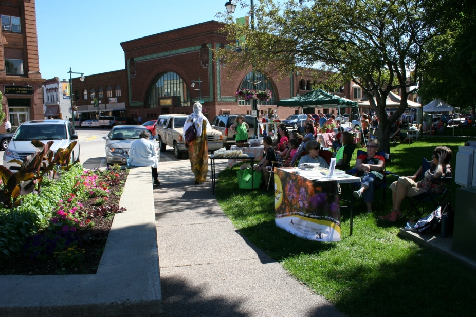 Another shot of the busy market, which gets even busier once gardens really begin producing. Then vendors are set up along the sidewalk and on the grass.