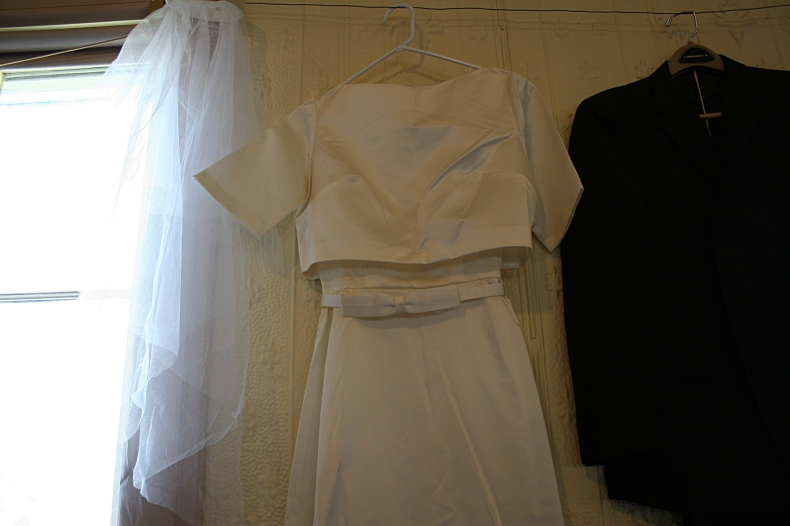 Iylene's wedding dress (which she sewed) and veil and Merlin's suit.