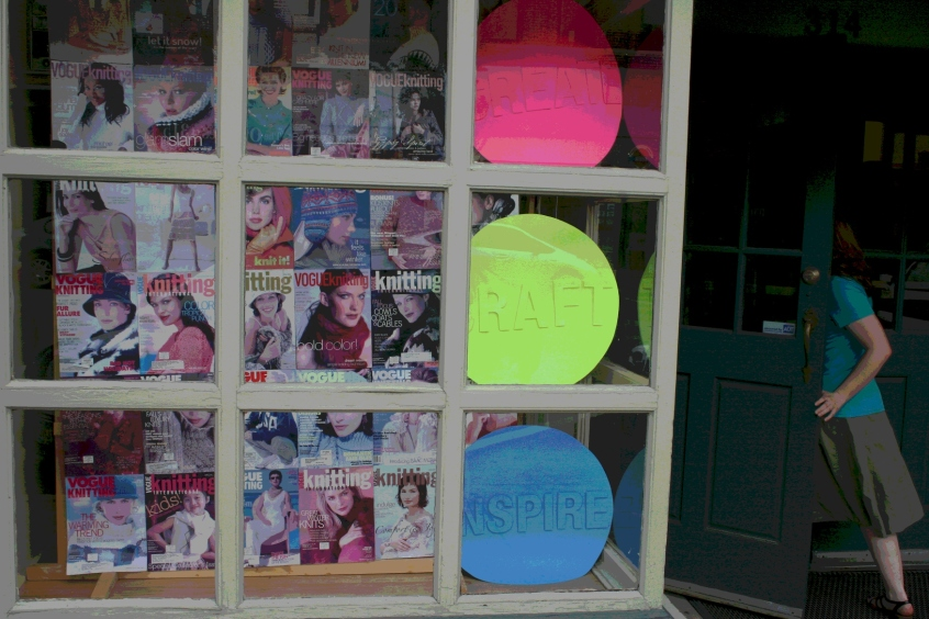 An eye-catching window display at the Yarn Shop. (Photo edited.)