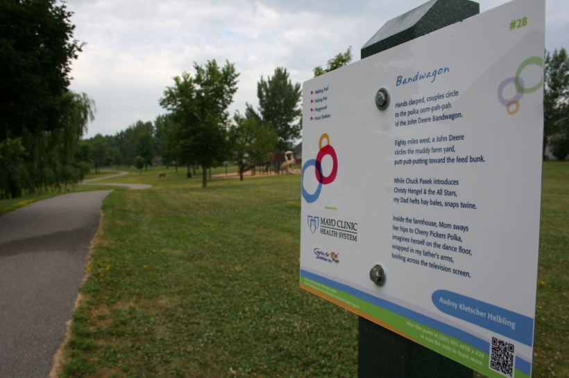 A recreational trail winds past my poetry sign in Lions Park North.
