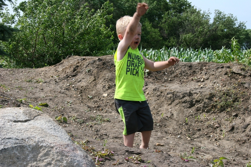 Boy throwing dirt