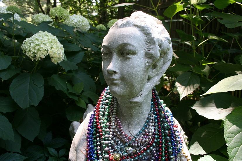 At first glance, I thought this simply a woman draped in beaded necklaces.