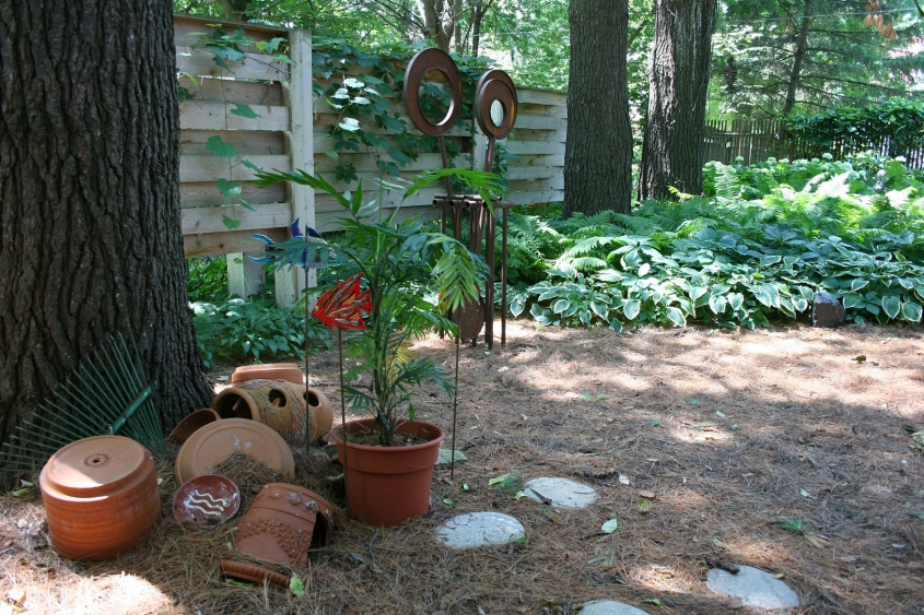 The garden art includes original sculptures by Jennifer Wolcott.