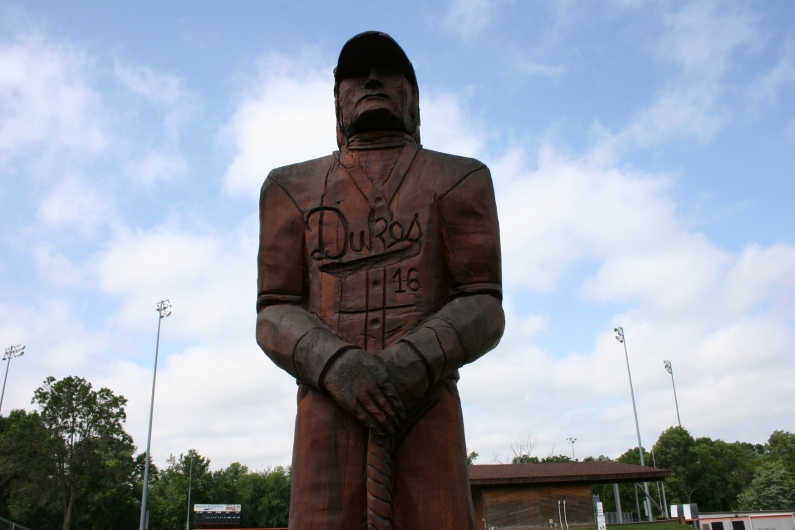 A carving of a Dundas Dukes baseball player stands just outisde the baseball field in Dundas.