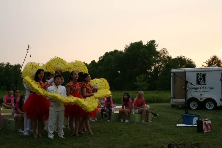 Chinese youth perform as the sun sets.