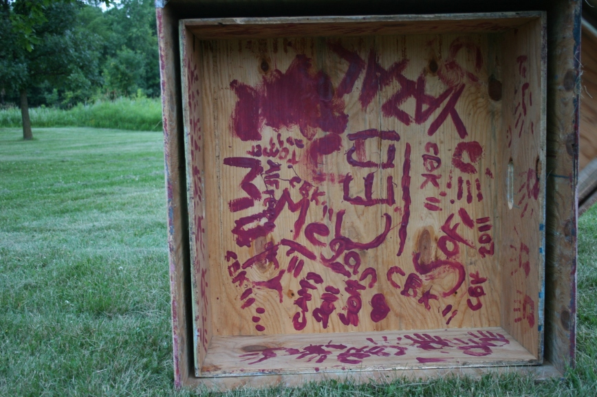 Participating youth from all over the world paint their names on the underside of boxes upon which they perform.