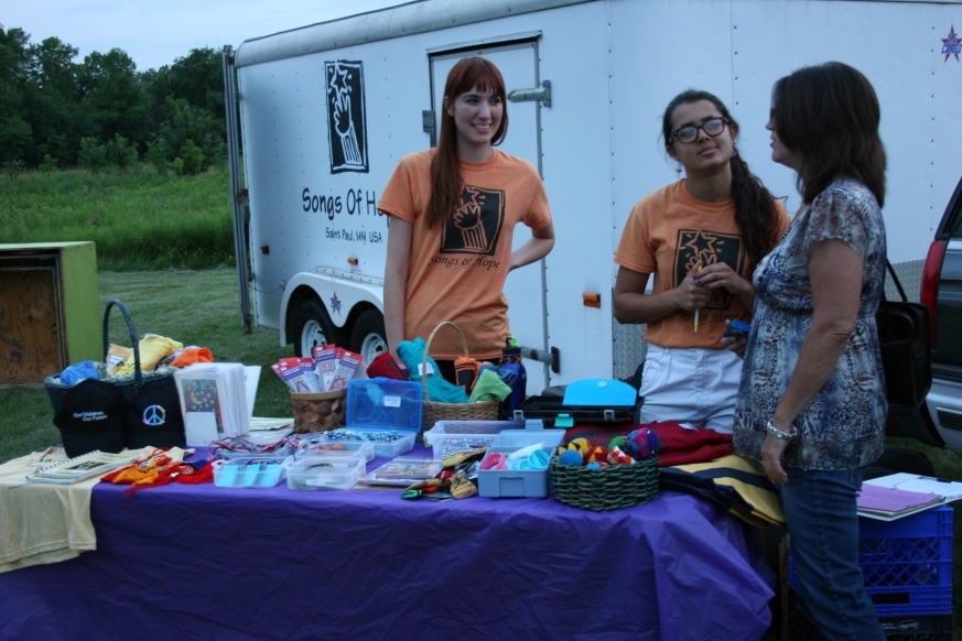 After the concert, goods from various countries and more were available for purchase. The young woman on the left is a native of Argentina who works as an opera singer in France. She's in the U.S. for a month with Songs of Hope.