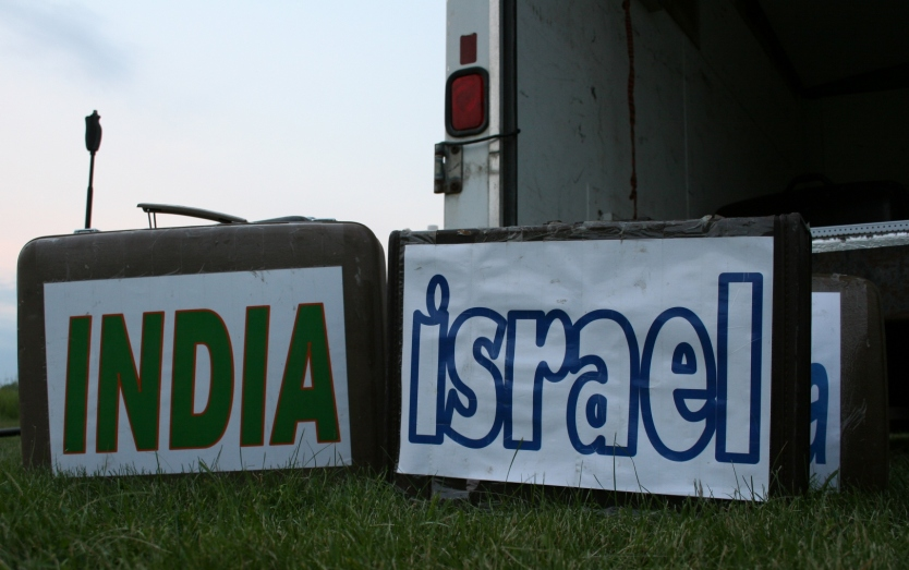 Labeled suitcases were placed on the grass to inform the audience of the culture featured.