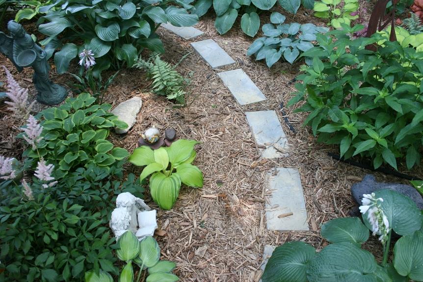 Shade-loving plants fill the Valhalla garden.