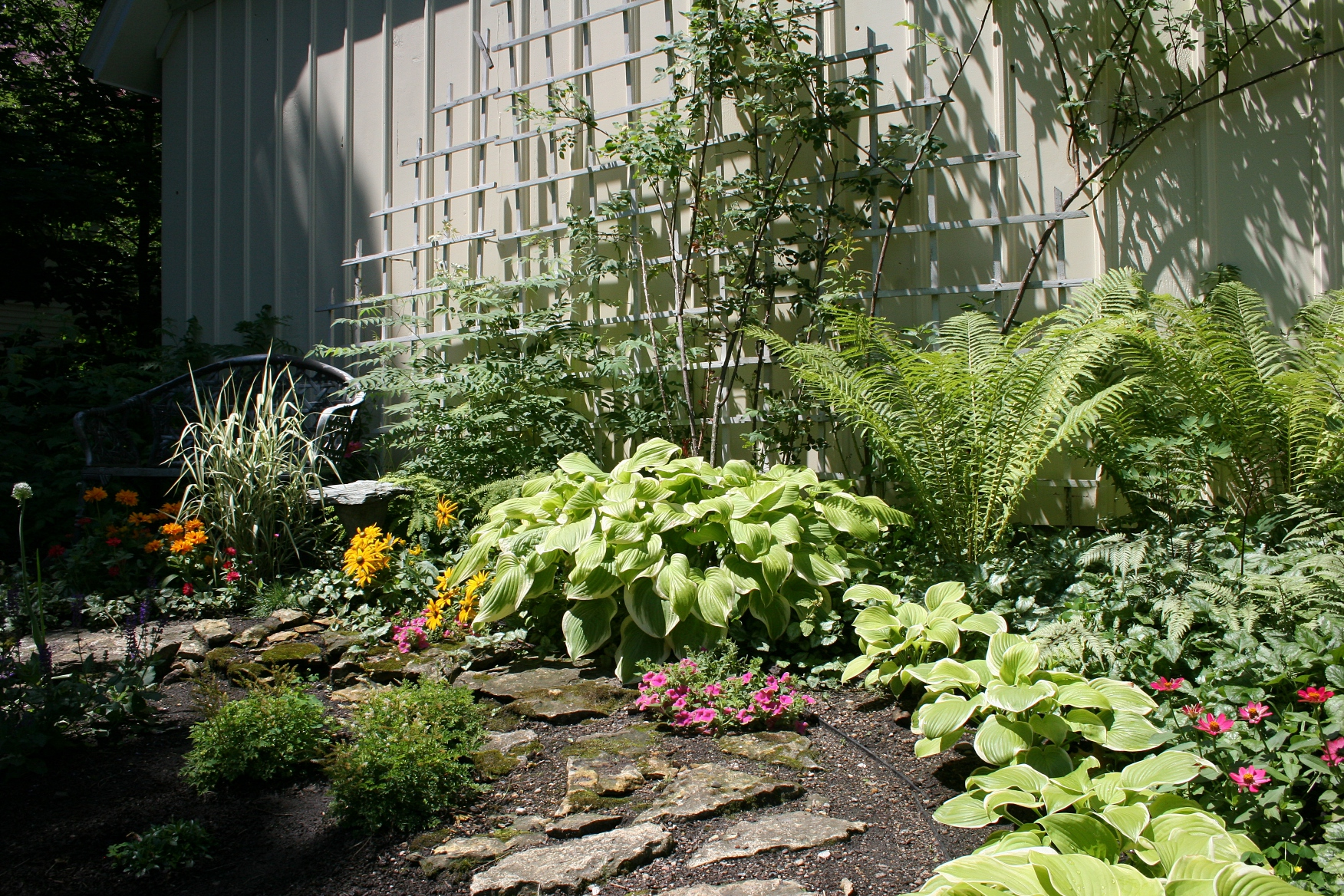 An Inviting Spot, Complete With Trellis, To Sit A Spell Next To The Garage