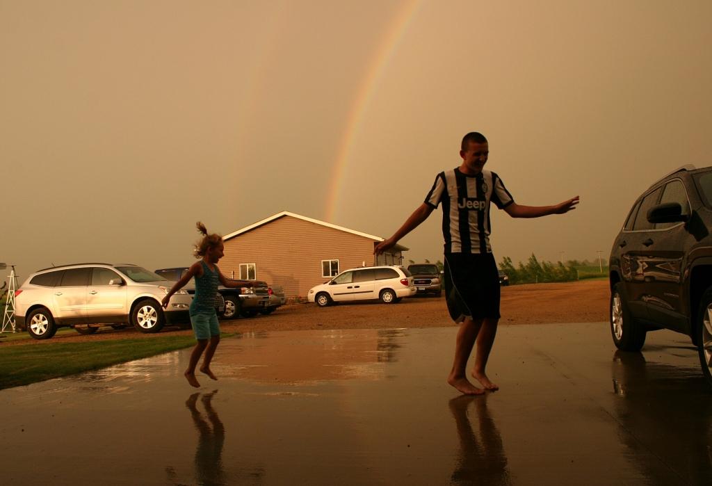 My nephew and great niece dance in the rain.