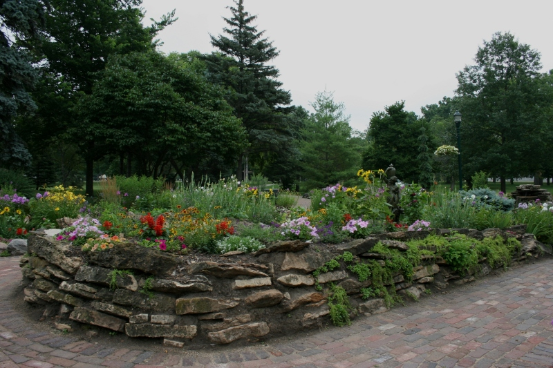 The garden includes a fountain tucked among the flowers.