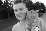 A boy and his cat, ruralBigelow
