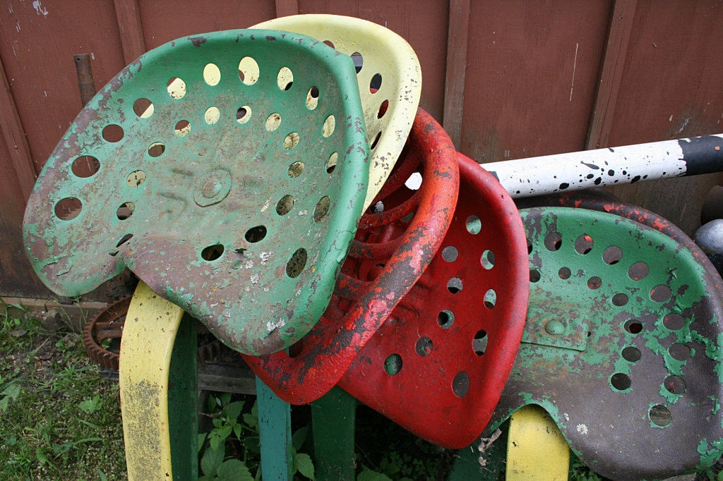 Seats from farm implements appear as art to my eyes.
