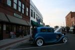 Faribault car show, blue car and downtownbuildings
