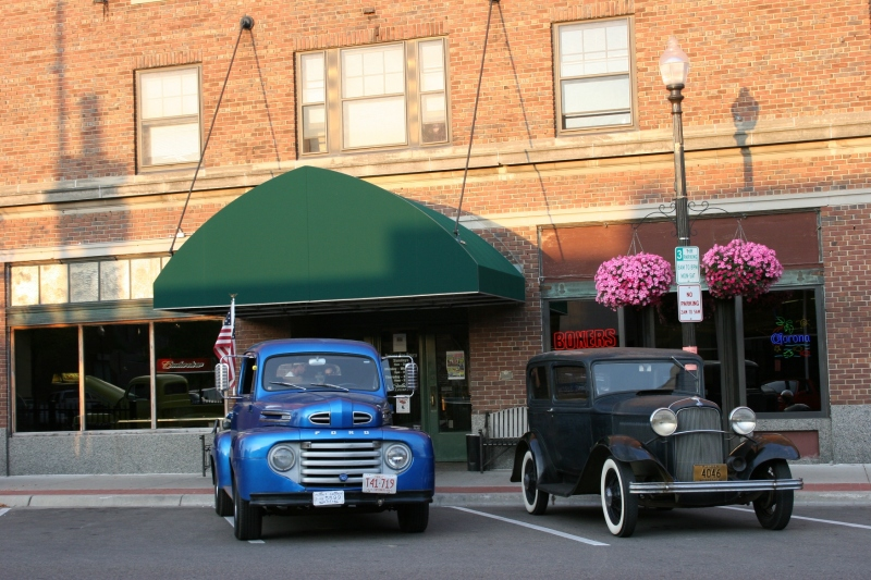Two of the numerous vehicles parked in downtown Faribault Friday evening for the last Car Cruise Night of the season.