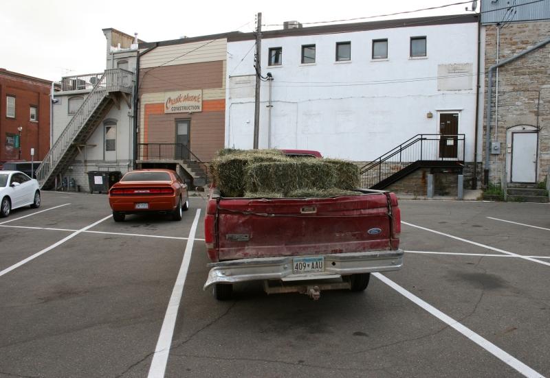 Hay bales in pickup, back view