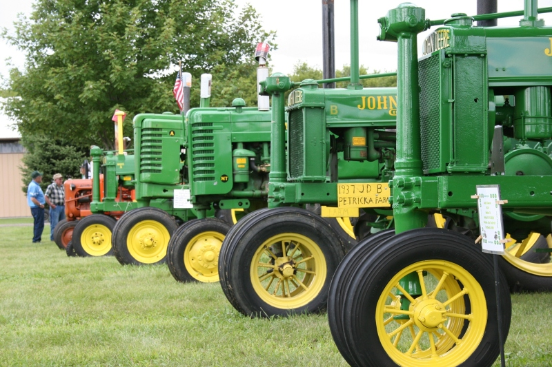 Rows and rows of tractors, including these John Deeres, line the grounds.