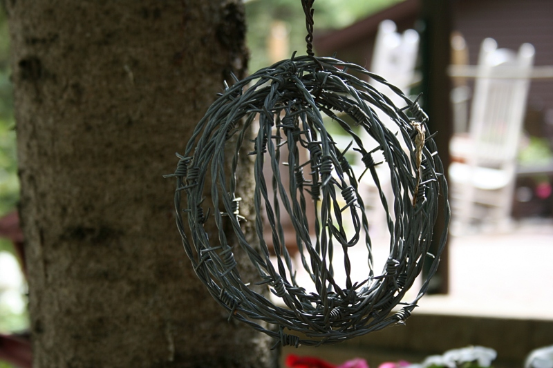 Seriously, how does one shape barbed wire into a ball?
