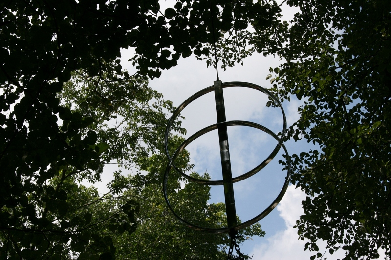 A snippet of an art piece dangling high in the trees.
