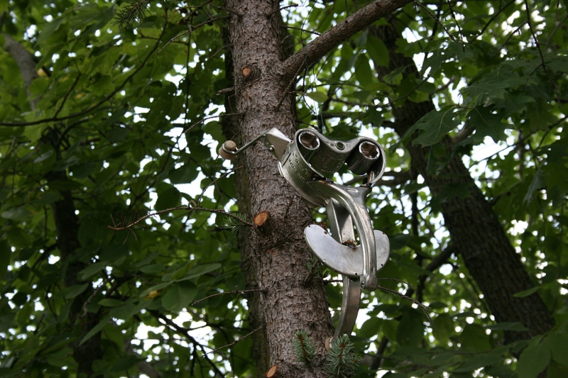 Who thinks of using a vintage meat grinder for art, then suspending it in a tree? Steve.