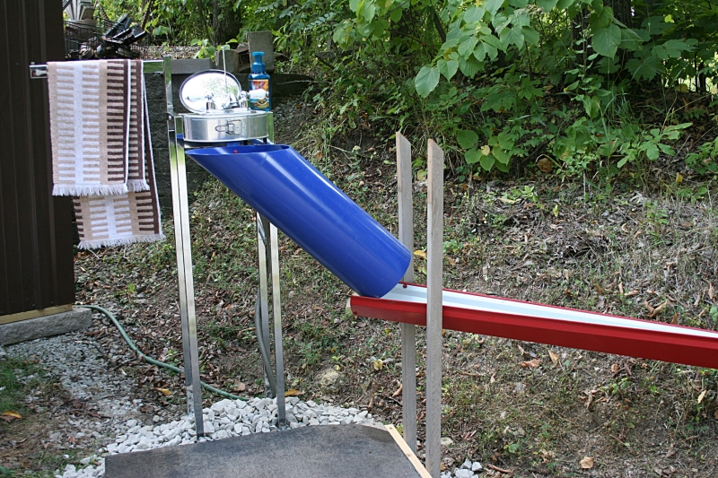 A portable outdoor functioning sink created with old faucets, springform pan, plastic pipes and more.