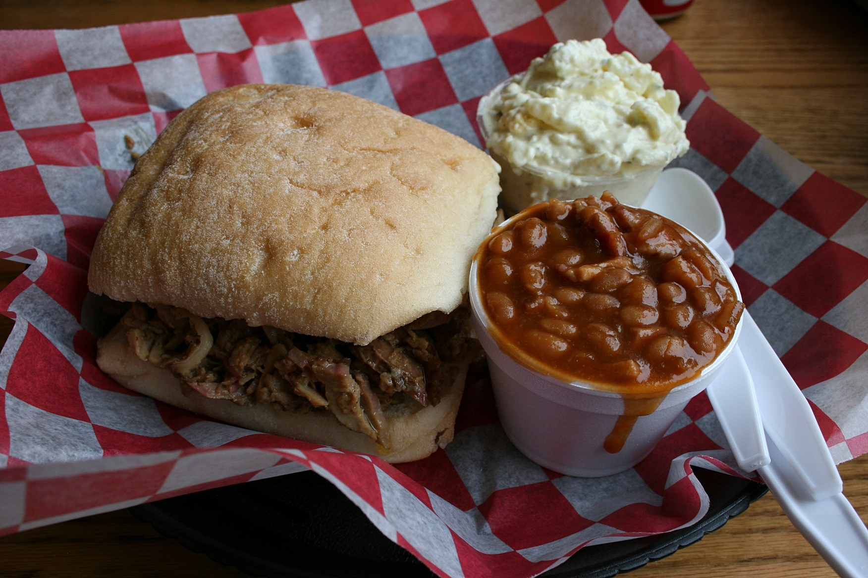 My Southern Bbq Pork Sandwich Served With Savory Baked Beans And Potato Salad