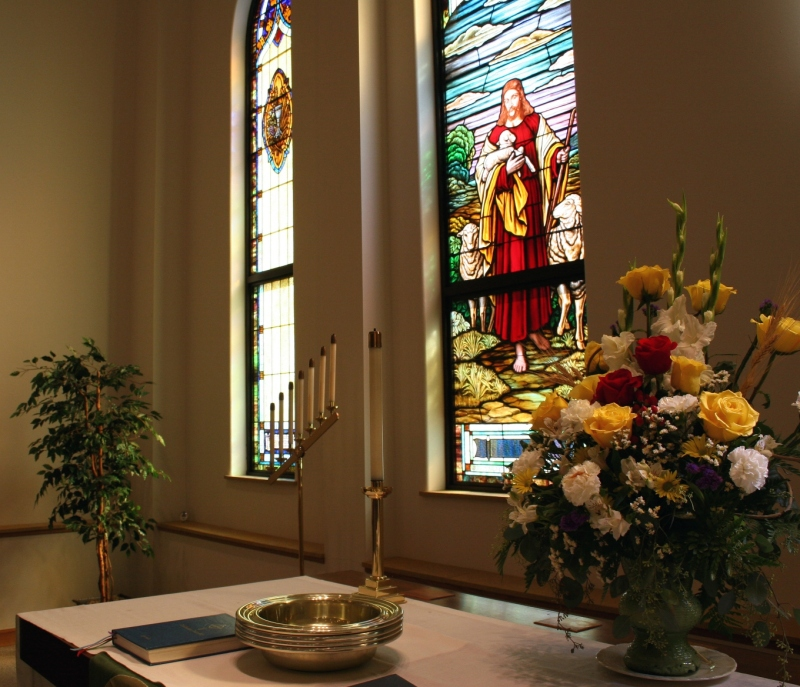 Beautiful aged stained glass windows highlight the sanctuary.