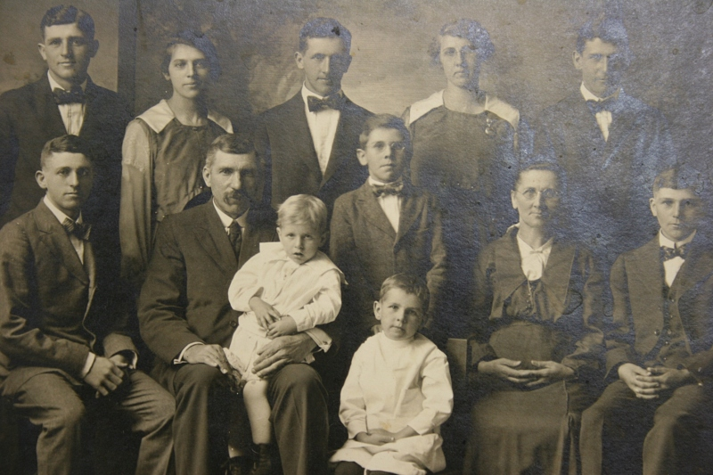 Karl Jr. and Anna Bode, their nine children and a daughter-in-law. That's by grandpa, Lawrence (originally spelled Lorenz) in the front row in the white dress.