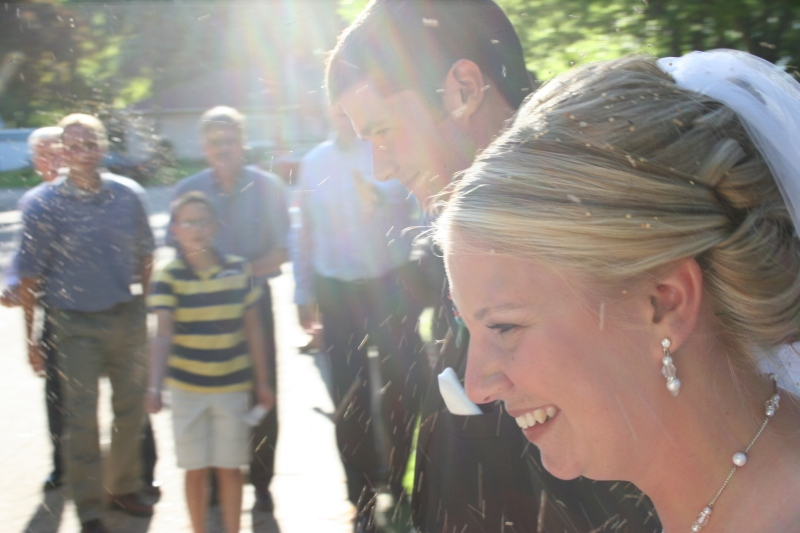 Carlyn and Jared leave the church in the early evening, showered with birdseed.