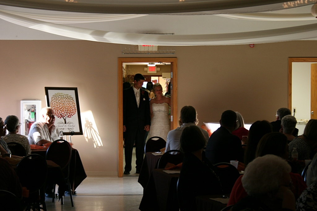 Jared and Carlyn await their introduction and entry into the reception hall.