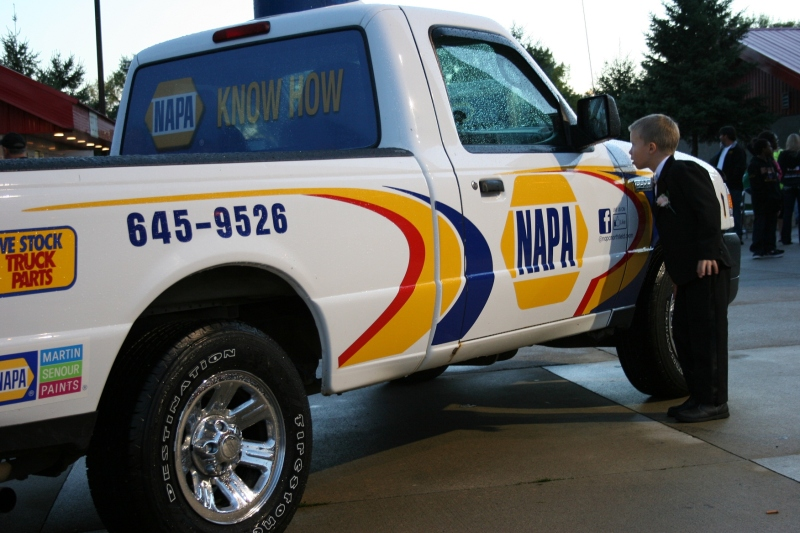 The ring bearer was especially interested in the NAPA truck, peering inside and trying the door.