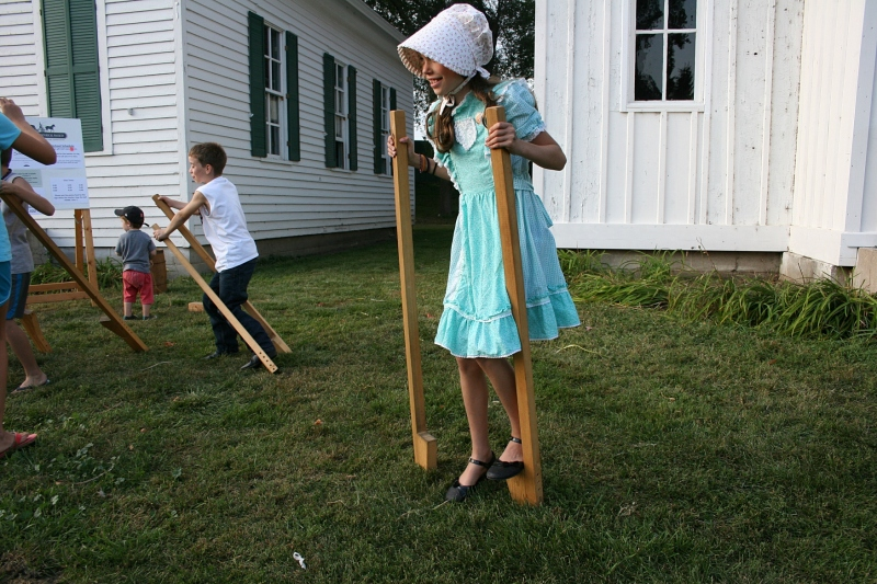 Kids loved trying to walk on stilts.