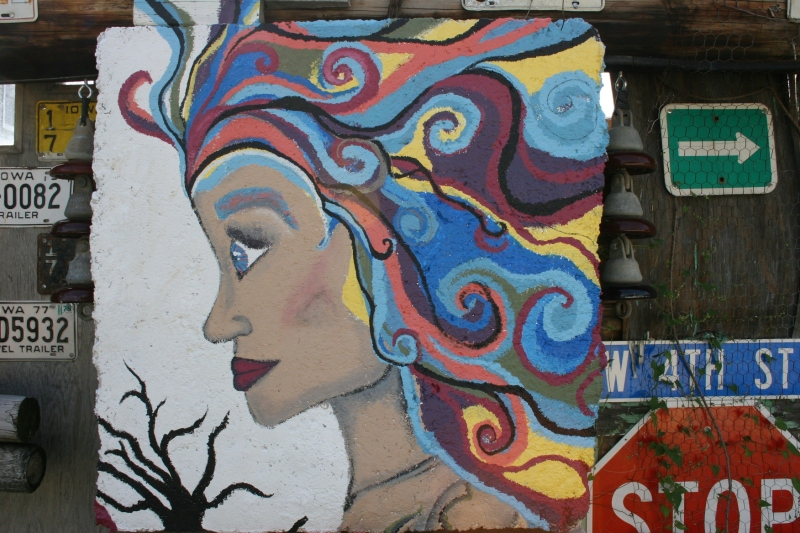 Love the vibrant colors and the art painted on a cement block.