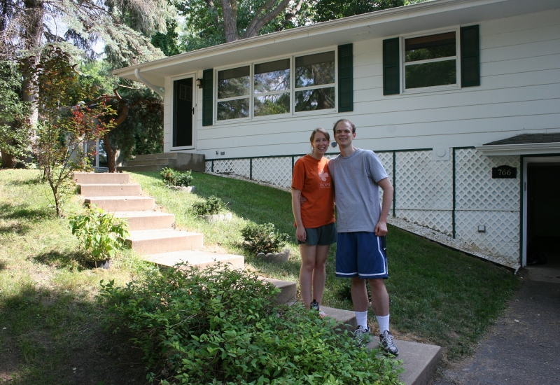 My eldest daughter, Amber, and her husband, Marc, pose in front of the home they recently purchased in a Twin Cities suburb. Minnesota Prairie Roots file photo.