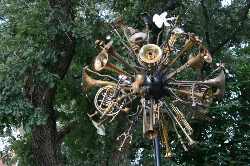 """""""Kinetic Weather Disturbance Ensemble,"""" a sculpture by Douglas Walker, is located at one end of the bridge. It is now part of the city's permanent sculpture collection."""