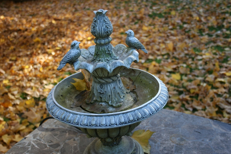 I'm in no hurry to rake the leaves in my backyard. This fountain rests on a patio table.