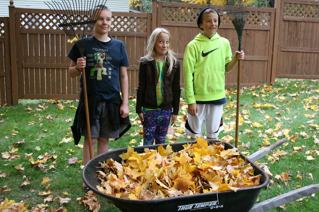 Posing Grant Wood style after raking leaves.