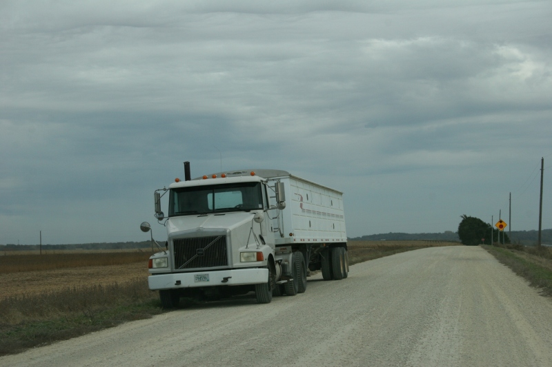 A semi ready to be filled with corn.