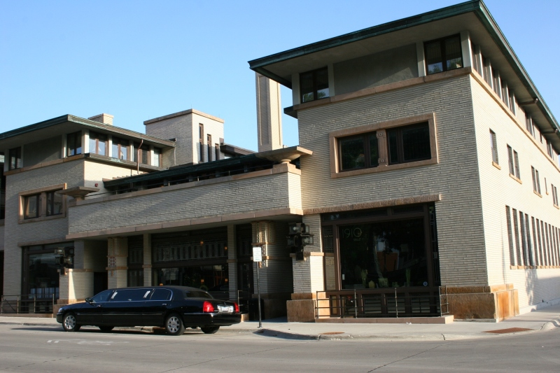 The 1910 Grille sits to the right with the hotel entry in the middle and the former bank to the left.